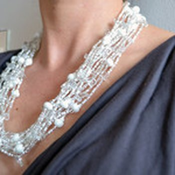 Necklace white with 12 strands of pearls